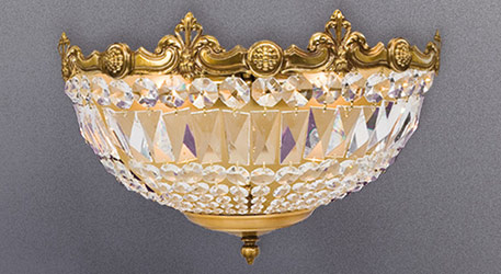 crystal wall light with golden ornaments